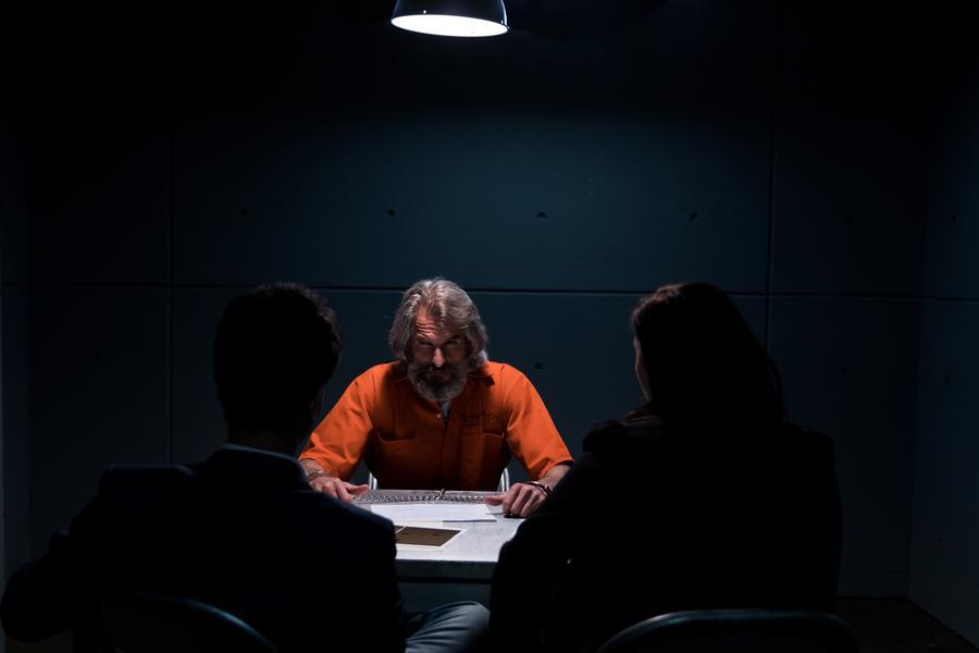 a-prisoner-in-an-interrogation-room-glares-at-detectives_900x (1)